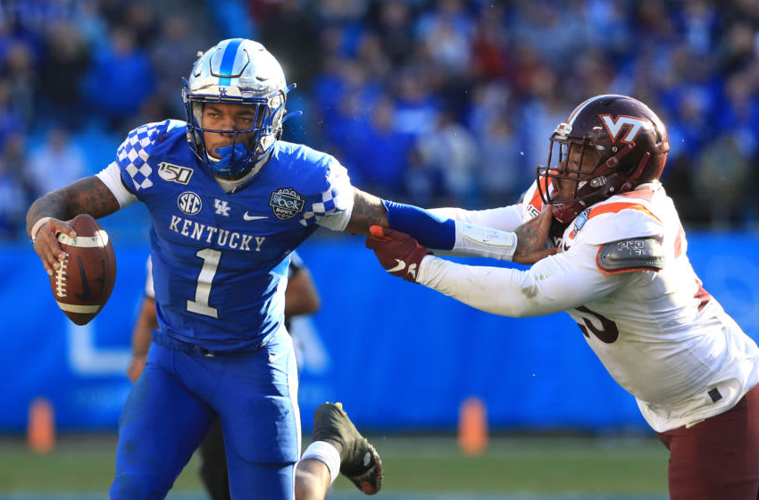 CHARLOTTE, NORTH CAROLINA - DECEMBER 31: Rayshard Ashby #23 of the Virginia Tech Hokies tries to stop Lynn Bowden Jr. #1 of the Kentucky Wildcats as he runs with the ball during the Belk Bowl at Bank of America Stadium on December 31, 2019 in Charlotte, North Carolina. (Photo by Streeter Lecka/Getty Images)