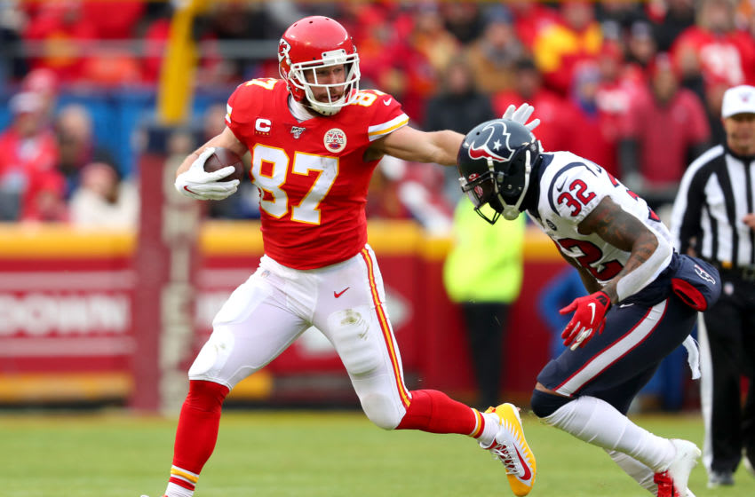 KANSAS CITY, MISSOURI - JANUARY 12: Travis Kelce #87 of the Kansas City Chiefs is pursued by Lonnie Johnson Jr. #32 of the Houston Texans during the first quarter in the AFC Divisional playoff game at Arrowhead Stadium on January 12, 2020 in Kansas City, Missouri. (Photo by Tom Pennington/Getty Images)