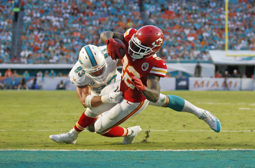 MIAMI GARDENS, FL - SEPTEMBER 21: Jason Trusnik #93 of the Miami Dolphins is unable to prevent Joe McKnight #22 of the Kansas City Chiefs from scoring a touchdown on September 21, 2014 at Sun Life Stadium in Miami Gardens, Florida. The Chiefs defeat the Dolphins 34-15. (Photo by Joel Auerbach/Getty Images)