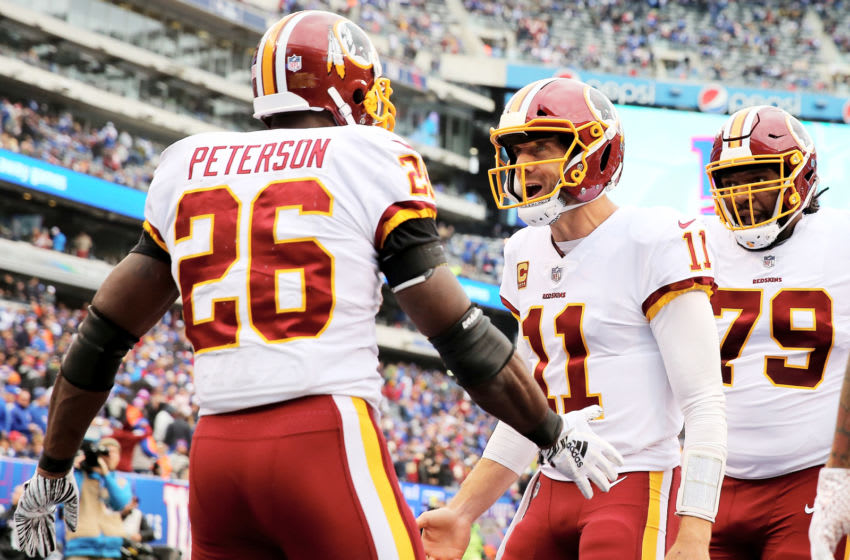 EAST RUTHERFORD, NJ - OCTOBER 28: Adrian Peterson #26 of the Washington Redskins celebrates his touchdown with quarterback Alex Smith #11 in the fourth quarter against the New York Giants on October 28,2018 at MetLife Stadium in East Rutherford, New Jersey. (Photo by Elsa/Getty Images)