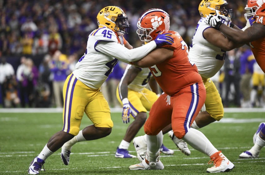 NEW ORLEANS, LA - JANUARY 13: Michael Divinity Jr. #45 of the LSU Tigers and Jackson Carman #79 of the Clemson Tigers battle for position during the College Football Playoff National Championship held at the Mercedes-Benz Superdome on January 13, 2020 in New Orleans, Louisiana. (Photo by Justin Tafoya/Getty Images)