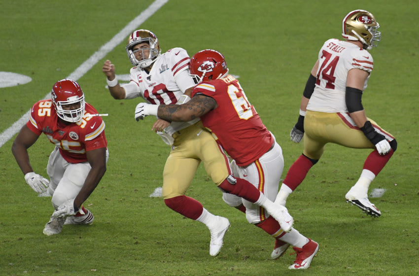 MIAMI, FLORIDA - FEBRUARY 02: Mike Pennel #64 of the Kansas City Chiefs puts the pressure on quarterback Jimmy Garoppolo #10 of the San Francisco 49ers in Super Bowl LIV at Hard Rock Stadium on February 02, 2020 in Miami, Florida. The Chiefs won the game 31-20. (Photo by Focus on Sport/Getty Images)