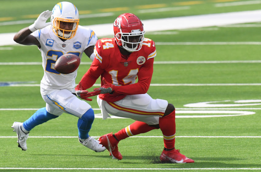 INGLEWOOD, CALIFORNIA - SEPTEMBER 20: Wide receiver Sammy Watkins #14 of the Kansas City Chiefs drops a pass in front of cornerback Casey Hayward #26 of the Los Angeles Chargers during the third quarter at SoFi Stadium on September 20, 2020 in Inglewood, California. (Photo by Harry How/Getty Images)