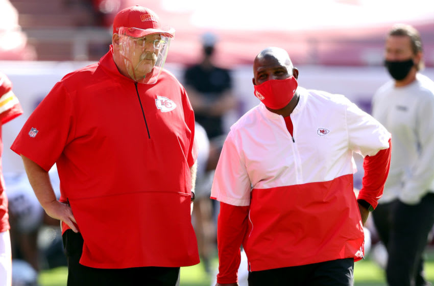 KANSAS CITY, MISSOURI - OCTOBER 11: Head coach Andy Reid of the Kansas City Chiefs speaks with offensive coordinator Eric Bieniemy prior to the game against the Las Vegas Raiders at Arrowhead Stadium on October 11, 2020 in Kansas City, Missouri. (Photo by Jamie Squire/Getty Images)