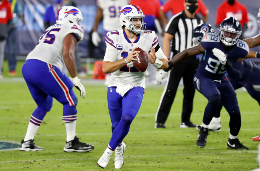 NASHVILLE, TENNESSEE - OCTOBER 13: Josh Allen #17 of the Buffalo Bills drops back to pass in the fourth quarter against the Tennessee Titans at Nissan Stadium on October 13, 2020 in Nashville, Tennessee. (Photo by Frederick Breedon/Getty Images)