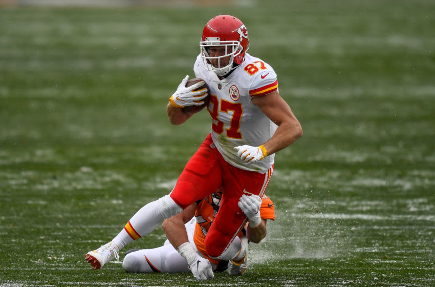 DENVER, CO - OCTOBER 25: Travis Kelce #87 of the Kansas City Chiefs runs after a catch as Josey Jewell #47 of the Denver Broncos tackles him in the third quarter of a game at Empower Field at Mile High on October 25, 2020 in Denver, Colorado. (Photo by Dustin Bradford/Getty Images)
