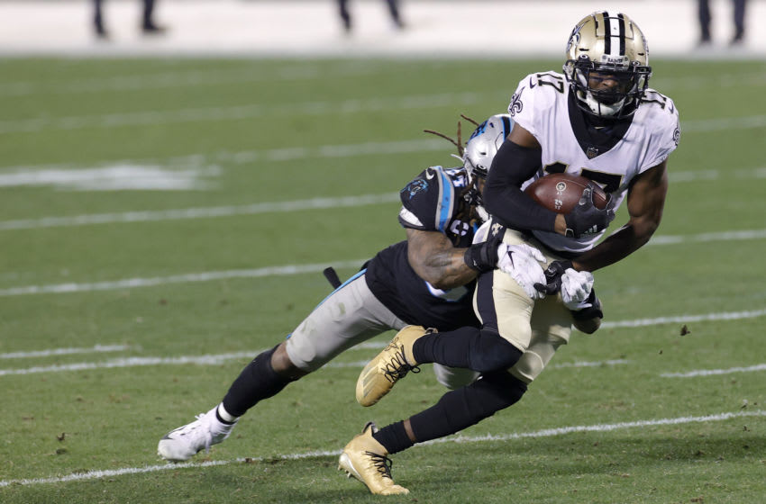 CHARLOTTE, NORTH CAROLINA - JANUARY 03: Wide receiver Emmanuel Sanders #17 of the New Orleans Saints is tackled by linebacker Shaq Thompson #54 of the Carolina Panthers during the second quarter of their game at Bank of America Stadium on January 03, 2021 in Charlotte, North Carolina. (Photo by Jared C. Tilton/Getty Images)