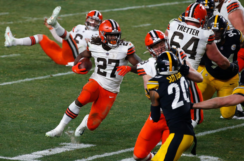 PITTSBURGH, PENNSYLVANIA - JANUARY 10: Kareem Hunt #27 of the Cleveland Browns runs for yards during the second half of the AFC Wild Card Playoff game against the Pittsburgh Steelers at Heinz Field on January 10, 2021 in Pittsburgh, Pennsylvania. (Photo by Justin K. Aller/Getty Images)