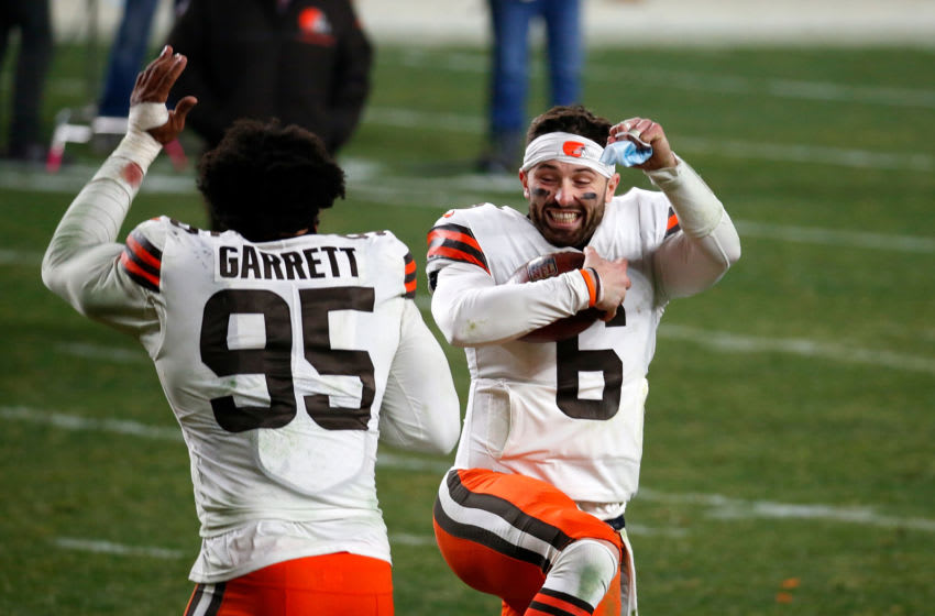 PITTSBURGH, PENNSYLVANIA - JANUARY 10: Baker Mayfield #6 and Myles Garrett #95 of the Cleveland Browns celebrate a victory over the Pittsburgh Steelers in the AFC Wild Card Playoff game at Heinz Field on January 10, 2021 in Pittsburgh, Pennsylvania. (Photo by Justin K. Aller/Getty Images)