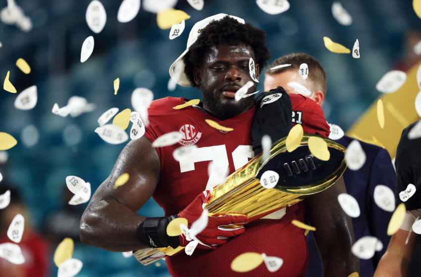 MIAMI GARDENS, FLORIDA - JANUARY 11: Alex Leatherwood #70 of the Alabama Crimson Tide holds the trophy following the College Football Playoff National Championship game win over the Ohio State Buckeyes at Hard Rock Stadium on January 11, 2021 in Miami Gardens, Florida. (Photo by Mike Ehrmann/Getty Images)
