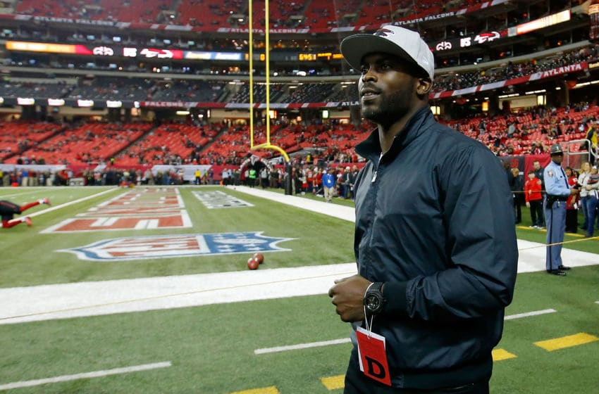 ATLANTA, GA - JANUARY 01: Former Atlanta Falcons player Michael Vick walks on the field prior to the game against the New Orleans Saints at the Georgia Dome on January 1, 2017 in Atlanta, Georgia. (Photo by Kevin C. Cox/Getty Images)