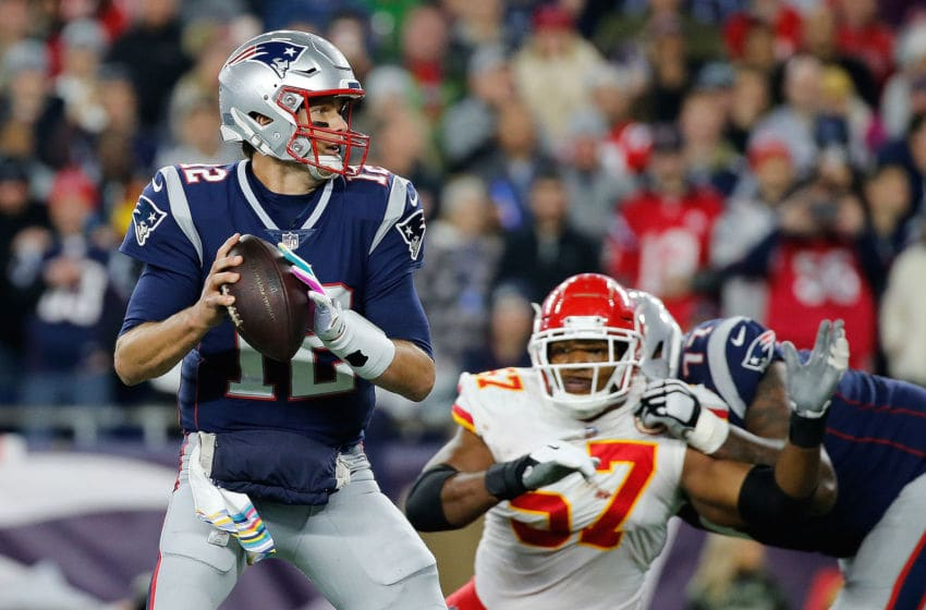 FOXBOROUGH, MA - OCTOBER 14: Tom Brady #12 of the New England Patriots feels the pressure of Breeland Speaks #57 of the Kansas City Chiefs in the fourth quarter at Gillette Stadium on October 14, 2018 in Foxborough, Massachusetts. Brady ran the ball in to the end zone for a touchdown on the play.(Photo by Jim Rogash/Getty Images)