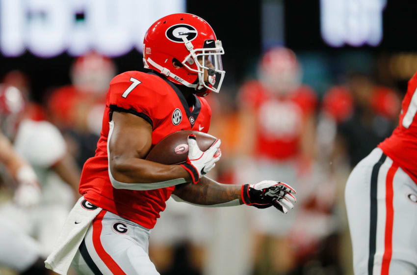 ATLANTA, GA - DECEMBER 01: D'Andre Swift #7 of the Georgia Bulldogs runs with the ball in the first half against the Alabama Crimson Tide during the 2018 SEC Championship Game at Mercedes-Benz Stadium on December 1, 2018 in Atlanta, Georgia. (Photo by Kevin C. Cox/Getty Images)