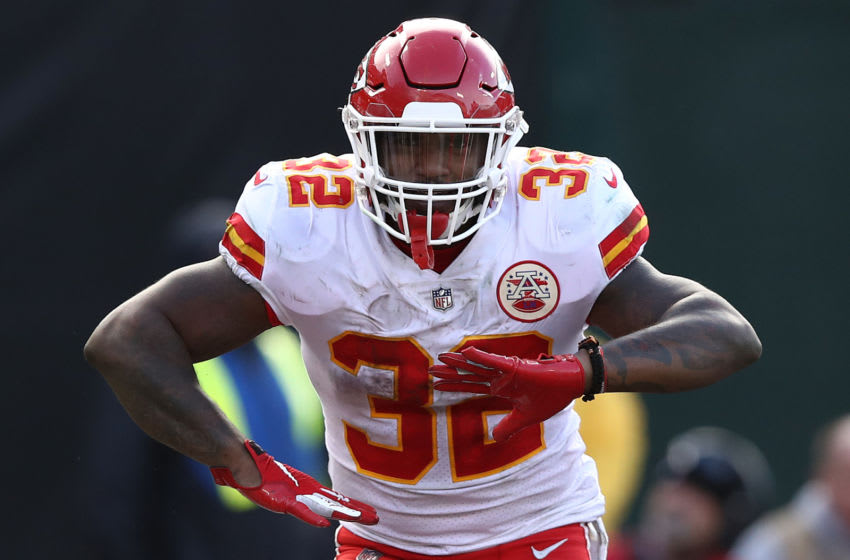 OAKLAND, CA - DECEMBER 02: Spencer Ware #32 of the Kansas City Chiefs celebrates after scoring against the Oakland Raiders during their NFL game at Oakland-Alameda County Coliseum on December 2, 2018 in Oakland, California. (Photo by Ezra Shaw/Getty Images)