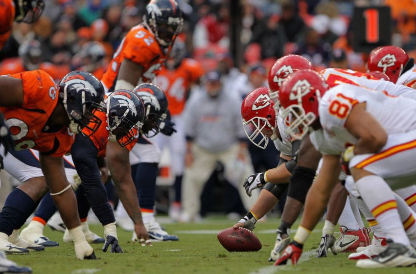 DENVER - NOVEMBER 14: The Kansas City Chiefs offensive line prepares to snap the ball against the Denver Broncos defense at INVESCO Field at Mile High on November 14, 2010 in Denver, Colorado. The Broncos defeated the Chiefs 49-29. (Photo by Doug Pensinger/Getty Images)