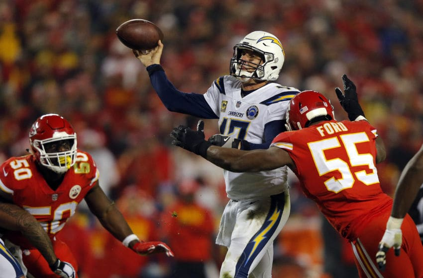 KANSAS CITY, MISSOURI - DECEMBER 13: Quarterback Philip Rivers #17 of the Los Angeles Chargers is hit by outside linebacker Dee Ford #55 of the Kansas City Chiefs during the game at Arrowhead Stadium on December 13, 2018 in Kansas City, Missouri. (Photo by David Eulitt/Getty Images)