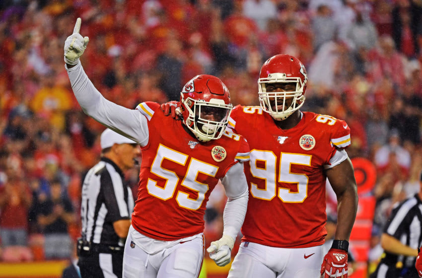KANSAS CITY, MO - AUGUST 24: Defensive end Frank Clark #55 of the Kansas City Chiefs celebrates with defensive end Chris Jones #95, after sacking quarterback Jimmy Garoppolo #10 of the San Francisco 49ers during the first half of a preseason game at Arrowhead Stadium on August 24, 2019 in Kansas City, Missouri. (Photo by Peter Aiken/Getty Images)