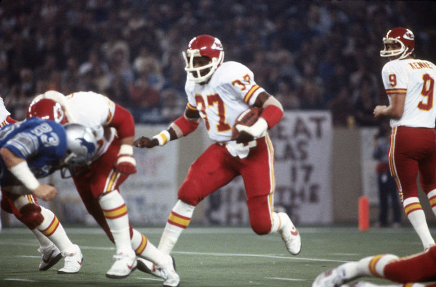 PONTIAC, MI - NOVEMBER 26: Joe Delaney #37 of the Kansas City Chiefs carries the ball against the Detroit Lions during an NFL football game November 26, 1981 at the Pontiac Silverdome in Pontiac, Michigan. Delaney played for the Chiefs from 1981-82. (Photo by Focus on Sport/Getty Images)