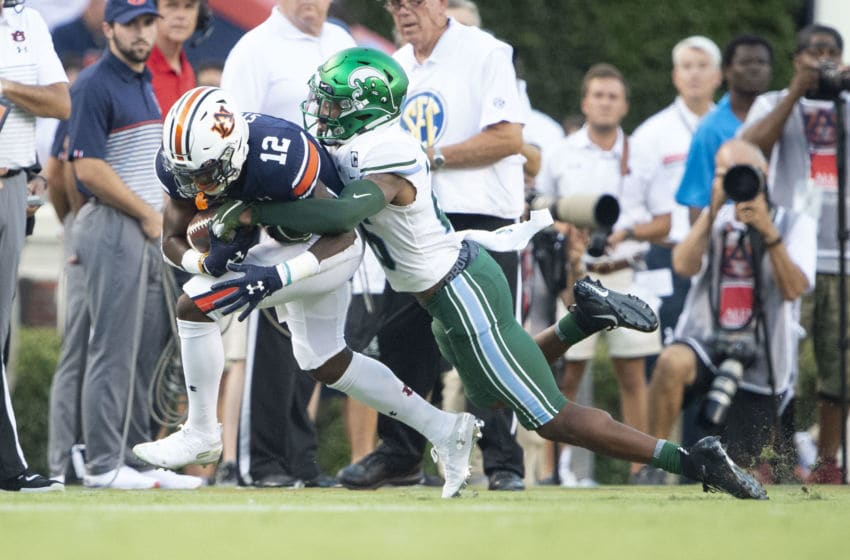AUBURN, AL - SEPTEMBER 07: Cornerback Thakarius Keyes #26 of the Tulane Green Wave looks to tackle wide receiver Eli Stove #12 of the Auburn Tigers at Jordan-Hare Stadium on September 7, 2019 in Auburn, Alabama. (Photo by Michael Chang/Getty Images)