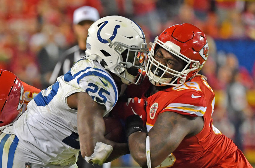 KANSAS CITY, MO - OCTOBER 06: Defensive tackle Khalen Saunders #99 of the Kansas City Chiefs tackles running back Marlon Mack #25 of the Indianapolis Colts during the second half at Arrowhead Stadium on October 6, 2019 in Kansas City, Missouri. (Photo by Peter Aiken/Getty Images)