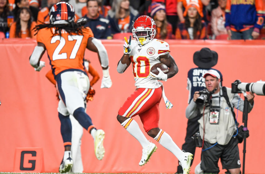 DENVER, CO - OCTOBER 17: Tyreek Hill #10 of the Kansas City Chiefs runs enroute to scoring a third-quarter touchdown against the Denver Broncos as Davontae Harris #27 of the Denver Broncos attempts to cover the play at Empower Field at Mile High on October 17, 2019 in Denver, Colorado. (Photo by Dustin Bradford/Getty Images)