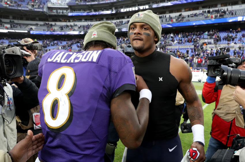 BALTIMORE, MARYLAND - NOVEMBER 17: Quarterbacks Lamar Jackson #8 of the Baltimore Ravens and Deshaun Watson #4 of the Houston Texans embrace following the Ravens win at M&T Bank Stadium on November 17, 2019 in Baltimore, Maryland. (Photo by Rob Carr/Getty Images)
