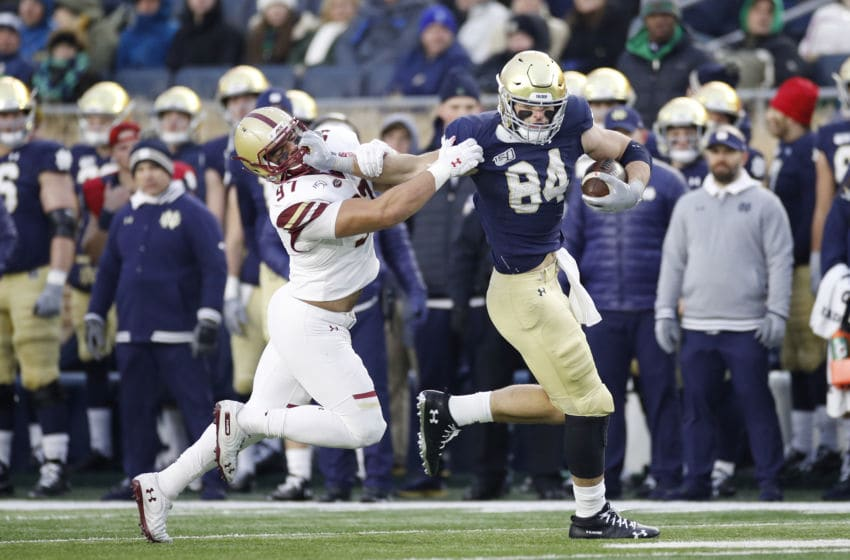 SOUTH BEND, IN - NOVEMBER 23: Cole Kmet #84 of the Notre Dame Fighting Irish runs after catching a pass against Marcus Valdez #97 of the Boston College Eagles in the second half at Notre Dame Stadium on November 23, 2019 in South Bend, Indiana. Notre Dame defeated Boston College 40-7. (Photo by Joe Robbins/Getty Images)