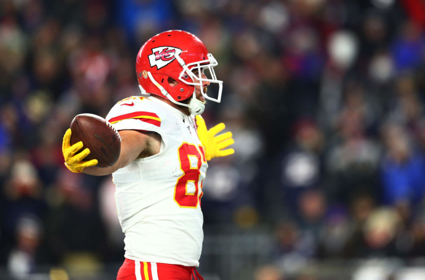 FOXBOROUGH, MASSACHUSETTS - DECEMBER 08: Travis Kelce #87 of the Kansas City Chiefs celebrates after rushing for a 4-yard touchdown during the second quarter against the New England Patriots in the game at Gillette Stadium on December 08, 2019 in Foxborough, Massachusetts. (Photo by Adam Glanzman/Getty Images)