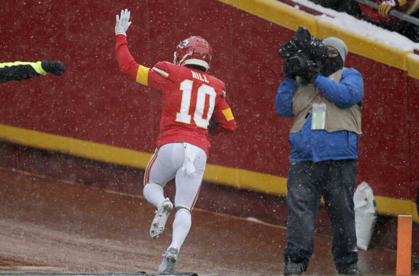 KANSAS CITY, MISSOURI - DECEMBER 15: Tyreek Hill #10 of the Kansas City Chiefs celebrates after a 41-yard touchdown against the Denver Broncos in the game at Arrowhead Stadium on December 15, 2019 in Kansas City, Missouri. (Photo by David Eulitt/Getty Images)