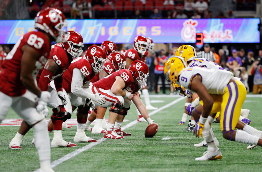 ATLANTA, GEORGIA - DECEMBER 28: Creed Humphrey #56 of the Oklahoma Sooners prepares to snap the ball at the line of scrimmage against the LSU Tigers during the Chick-fil-A Peach Bowl at Mercedes-Benz Stadium on December 28, 2019 in Atlanta, Georgia. (Photo by Kevin C. Cox/Getty Images)