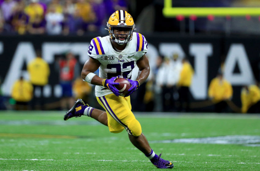 NEW ORLEANS, LOUISIANA - JANUARY 13: Clyde Edwards-Helaire #22 of the LSU Tigers runs the ball against the Clemson Tigers during the fourth quarter in the College Football Playoff National Championship game at Mercedes Benz Superdome on January 13, 2020 in New Orleans, Louisiana. (Photo by Mike Ehrmann/Getty Images)