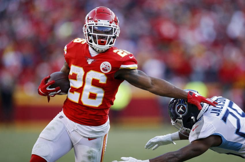 KANSAS CITY, MO - JANUARY 19: Damien Williams #26 of the Kansas City Chiefs runs with the ball during the AFC Championship game against the Tennessee Titans at Arrowhead Stadium on January 19, 2020 in Kansas City, Missouri. The Chiefs defeated the Titans 35-24. (Photo by Joe Robbins/Getty Images)