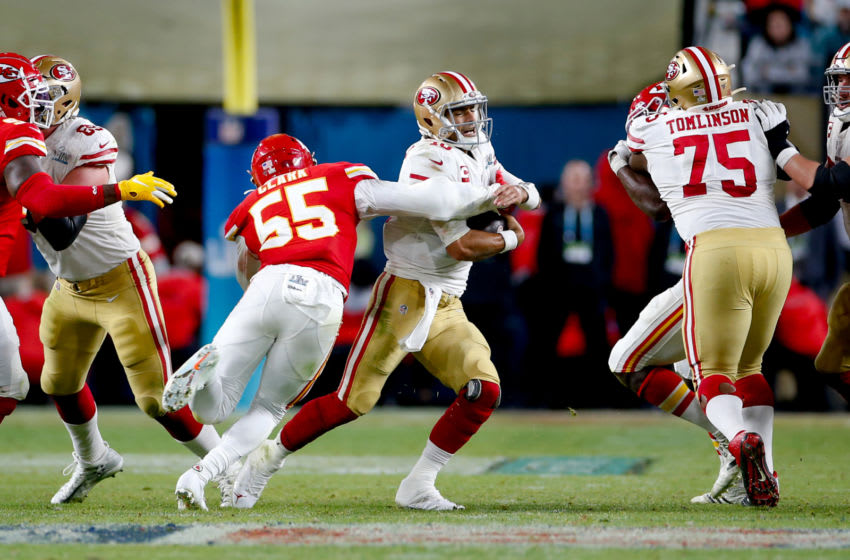 MIAMI, FLORIDA - FEBRUARY 2: Frank Clark #55 of the Kansas City Chiefs sacks Jimmy Garoppolo #10 of the San Francisco 49ers in Super Bowl LIV at Hard Rock Stadium on February 2, 2020 in Miami, Florida. The Chiefs defeated the 49ers 31-20. (Photo by Michael Zagaris/San Francisco 49ers/Getty Images)
