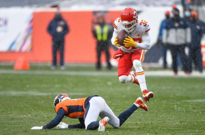 DENVER, CO - OCTOBER 25: Tyrann Mathieu #32 of the Kansas City Chiefs intercepts a pass intended for K.J. Hamler #13 of the Denver Broncos in the fourth quarter during a game at Empower Field at Mile High on October 25, 2020 in Denver, Colorado. (Photo by Dustin Bradford/Getty Images)