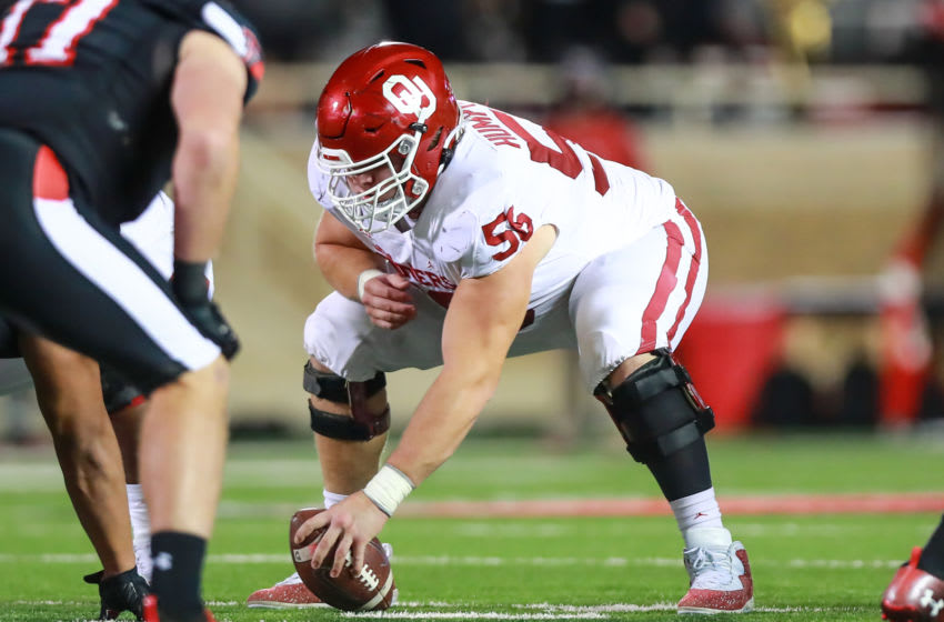 LUBBOCK, TEXAS - OCTOBER 31: Center Creed Humphrey #56 of the Oklahoma Sooners snaps the ball during the first half of the college football game against the Texas Tech Red Raiders at Jones AT&T Stadium on October 31, 2020 in Lubbock, Texas. (Photo by John E. Moore III/Getty Images)