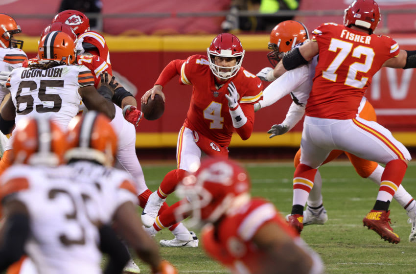 KANSAS CITY, MISSOURI - JANUARY 17: Quarterback Chad Henne #4 of the Kansas City Chiefs scrambles against the defense of the Cleveland Browns late in the fourth quarter of the AFC Divisional Playoff game at Arrowhead Stadium on January 17, 2021 in Kansas City, Missouri. (Photo by Jamie Squire/Getty Images)
