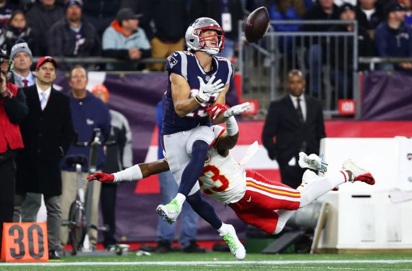 FOXBOROUGH, MA - OCTOBER 14: Chris Hogan #15 of the New England Patriots makes a catch while under pressure from Kendall Fuller #23 of the Kansas City Chiefs in the fourth quarter of a game at Gillette Stadium on October 14, 2018 in Foxborough, Massachusetts. (Photo by Adam Glanzman/Getty Images)