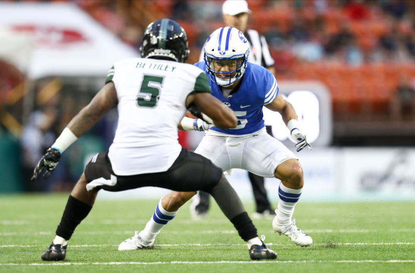 HONOLULU, HI - DECEMBER 24: Aleva Hifo #15 of the BYU Cougars looks to get past Khoury Bethley #5 of the Hawaii Rainbow Warriors during the third quarter of the Hawai'i Bowl at Aloha Stadium on December 24, 2019 in Honolulu, Hawaii. (Photo by Darryl Oumi/Getty Images)