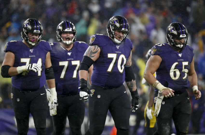 BALTIMORE, MD - DECEMBER 29: Parker Ehinger #70 of the Baltimore Ravens walks with teammates after a play against the Pittsburgh Steelers during the second half at M&T Bank Stadium on December 29, 2019 in Baltimore, Maryland. (Photo by Scott Taetsch/Getty Images)