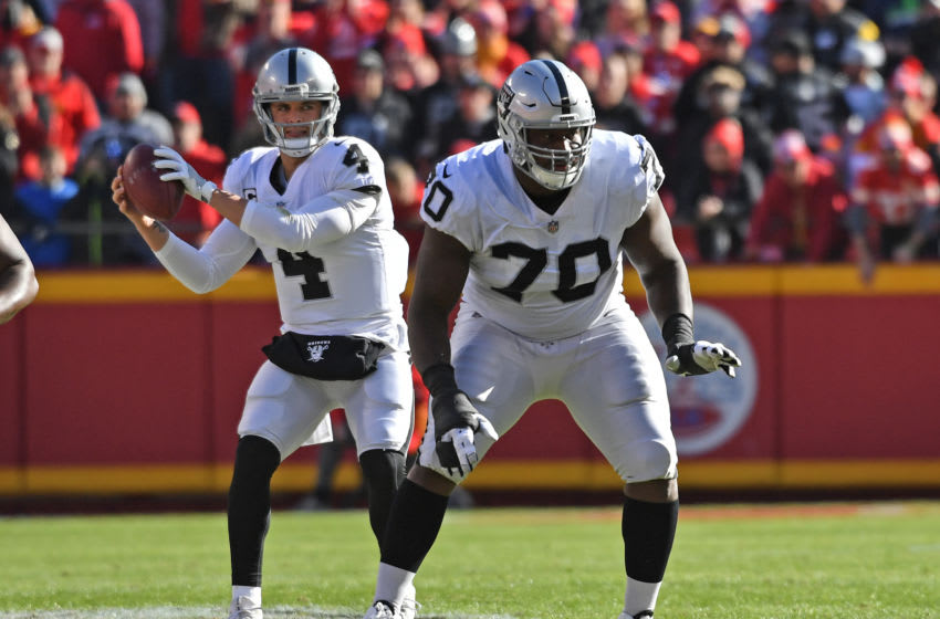 KANSAS CITY, MO - DECEMBER 10: Offensive guard Kelechi Osemele #70 of the Oakland Raiders gets set on the line as quarterback Derek Carr #4 looks to pass against the Kansas City Chiefs during the first half at Arrowhead Stadium on December 10, 2017 in Kansas City, Missouri. (Photo by Peter G. Aiken/Getty Images)