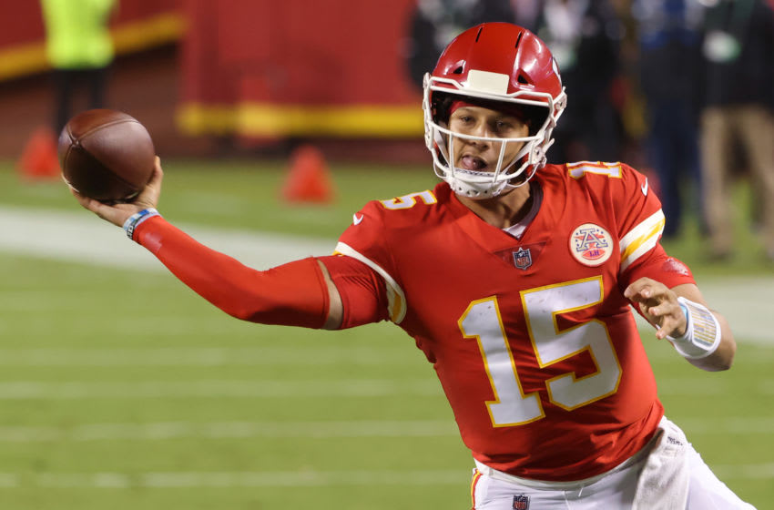 KANSAS CITY, MISSOURI - SEPTEMBER 10: Patrick Mahomes #15 of the Kansas City Chiefs throws a touchdown pass against the Houston Texans during the second quarter at Arrowhead Stadium on September 10, 2020 in Kansas City, Missouri. (Photo by Jamie Squire/Getty Images)