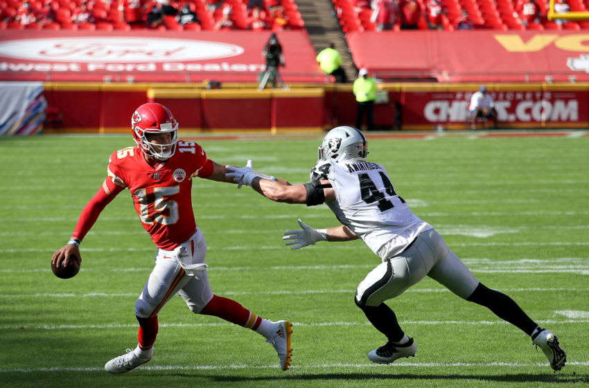 KANSAS CITY, MISSOURI - OCTOBER 11: Patrick Mahomes #15 of the Kansas City Chiefs is pursued by Nick Kwiatkoski #44 of the Las Vegas Raiders during the fourth quarter at Arrowhead Stadium on October 11, 2020 in Kansas City, Missouri. (Photo by Jamie Squire/Getty Images)