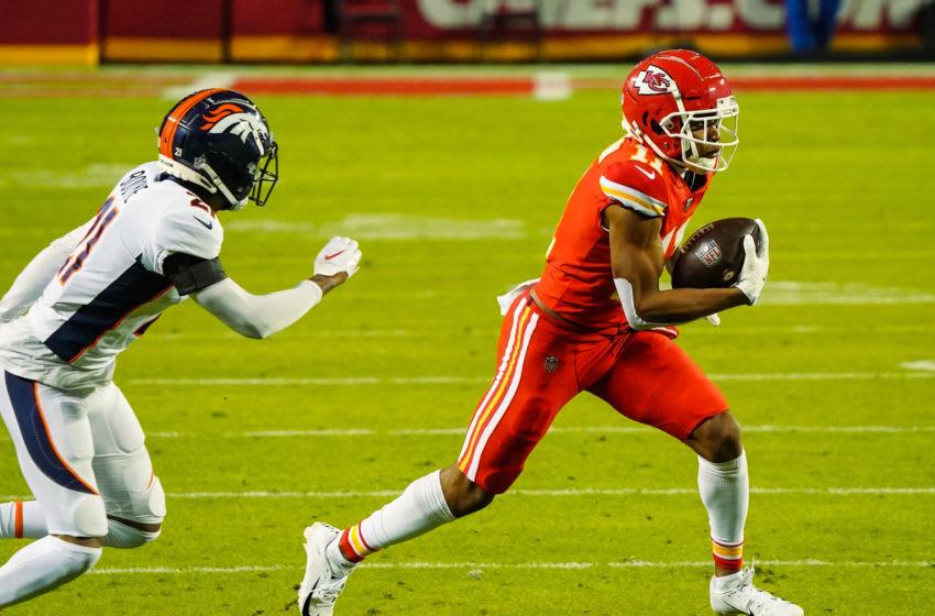 Dec 6, 2020; Kansas City, Missouri, USA; Kansas City Chiefs wide receiver Demarcus Robinson (11) runs against Denver Broncos cornerback A.J. Bouye (21) during the first half at Arrowhead Stadium. Mandatory Credit: Jay Biggerstaff-USA TODAY Sports