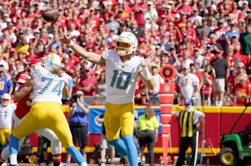 Sep 26, 2021; Kansas City, Missouri, USA; Los Angeles Chargers quarterback Justin Herbert (10) throws a pass against the Kansas City Chiefs during the first half at GEHA Field at Arrowhead Stadium. Mandatory Credit: Denny Medley-USA TODAY Sports