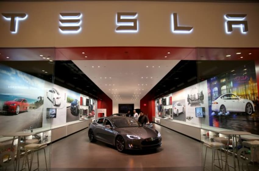 MIAMI, FL - FEBRUARY 19: People look at a Tesla Motors vehicle on the showroom floor at the Dadeland Mall on February 19, 2014 in Miami, Florida. Tesla said today it earned $46 million in the fourth quarter on a non-adjusted basis, or 33 cents a share, causing shares in the company to jump 12 percent. (Photo by Joe Raedle/Getty Images)