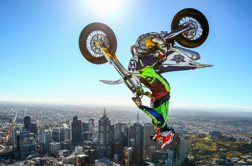MELBOURNE, AUSTRALIA - MAY 22: World Champion Trials bike rider Jack Field of Australia performs the highest backflip on a motorcycle ever recorded as he flips his motorbike upside down on the roof of Melbourne's Eureka Tower during a AUS-X Open media opportunity at Eureka Tower on May 22, 2019 in Melbourne, Australia. The largest international Supercross and action sports event in the world outside of the USA, the AUS-X Open will be held at Melbourne's Marvel Stadium on November 30 2019. (Photo by Scott Barbour/Getty Images)