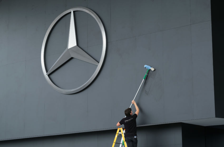 FRANKFURT AM MAIN, GERMANY - SEPTEMBER 09: A worker cleans the area around a giant logo of German automaker Mercedes-Benz prior to the Mercedes-Benz media preview at the 2019 IAA Frankfurt Auto Show on September 09, 2019 in Frankfurt am Main, Germany. The IAA will be open to the public from September 12 through 22. (Photo by Sean Gallup/Getty Images)