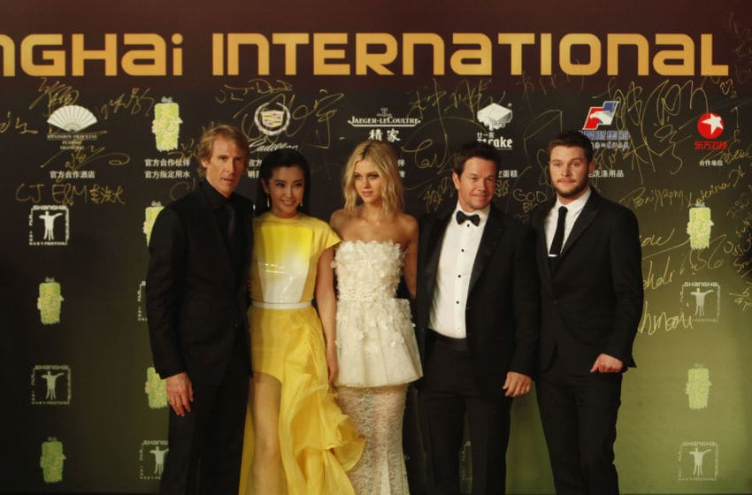 SHANGHAI, CHINA - JUNE 22: (L to R) Director Michael Bay, Li Bingbing, Nicola Peltzat, Mark Wahlberg, and Jack Reynor poses for a picture at the Shanghai premiere of 'Transformers' on June 22, 2014 in Shanghai, China. (Photo by Kevin Lee/Getty Images for Paramount)