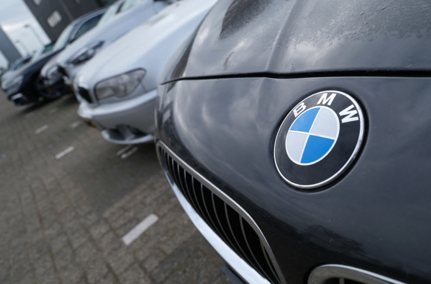 NOORDWIJK, NETHERLANDS - APRIL 26: A logo of German carmaker BMW is pictured on the company's vehicle parked outside its dealer on April 26, 2020 in Noordwijk, Netherlands. (Photo by Yuriko Nakao/Getty Images)