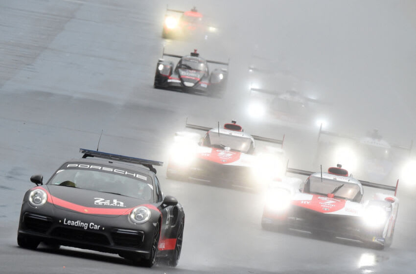 Safety car leads followed by Toyota TS050 Hybrid LMP1 WEC's British driver Mike Conway during the start of the 89th edition of Le Mans 24 Hours endurance race, in Le Mans, northwestern France, on August 21, 2021. (Photo by JEAN-FRANCOIS MONIER / AFP) (Photo by JEAN-FRANCOIS MONIER/AFP via Getty Images)
